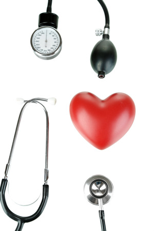 Tonometer, stethoscope and heart isolated on white photo