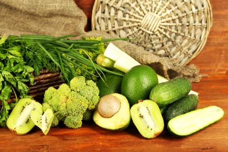 Fresh green vegetables and fruits, on wooden background Stock Photo - 22897722