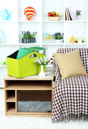 Magazines and folders in green box on bedside table in room Stock Photo - 22897740