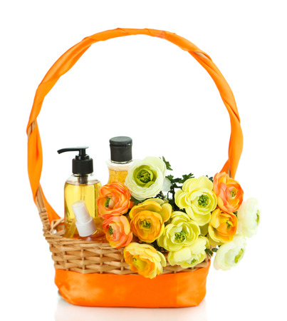 Gift basket with cosmetics isolated on white photo