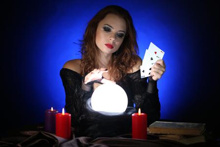Halloween witch on dark blue background photo