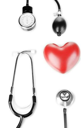 Tonometer, stethoscope and heart isolated on white Stock Photo - 22908769