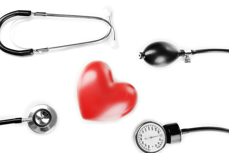 hypertensive: Tonometer, stethoscope and heart isolated on white