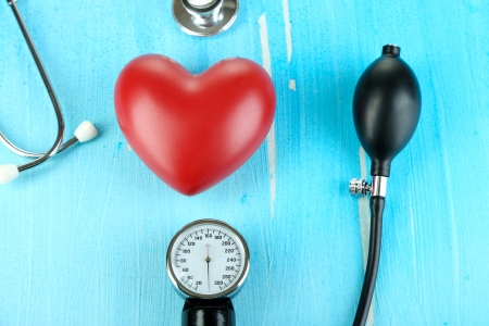 Tonometer, stethoscope and heart on wooden table close-up Stock Photo - 22908774