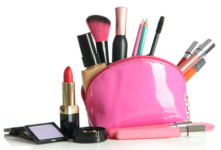open up: Beautiful make up bag with cosmetics , isolated on white