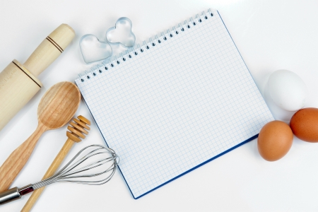 Cooking concept. Basic baking ingredients and kitchen tools close up photo