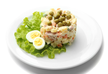Russian traditional salad Olivier, isolated on white Stock Photo