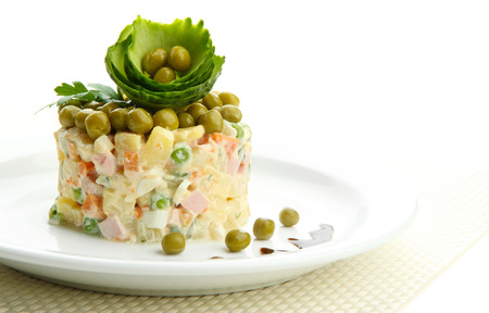 Russian traditional salad Olivier, isolated on white photo