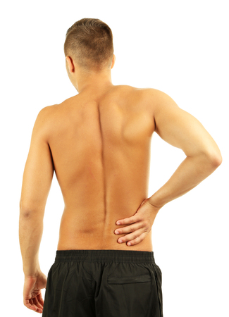 Young man with back pain, isolated on white photo