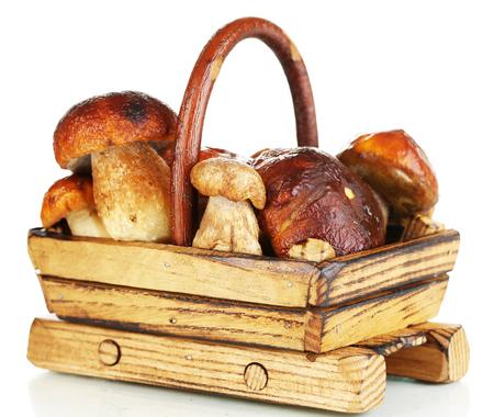 Fresh mushrooms in basket isolated on white photo