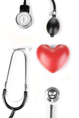 Tonometer, stethoscope and heart isolated on white Stock Photo - 23113537