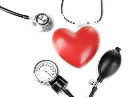 Tonometer, stethoscope and heart isolated on white Stock Photo - 23113632