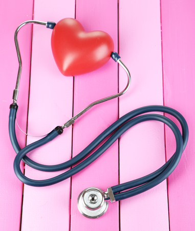 Stethoscope and heart on wooden table close-up Stock Photo - 23113634