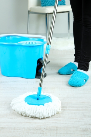 Mopping floor at home close-up photo