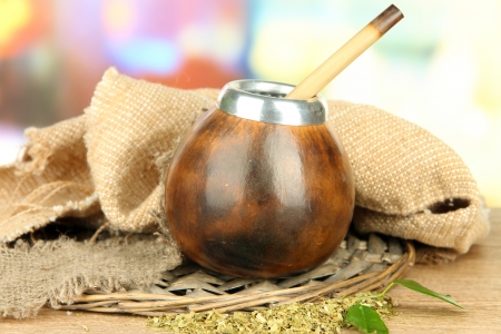 mate infusion: Calabash and bombilla with yerba mate on wooden table  Stock Photo