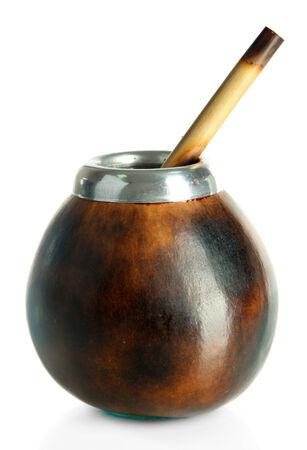 Calabash and bombilla with yerba mate isolated on white photo