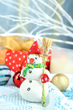 Beautiful Christmas composition with gift and Christmas toys close-up photo
