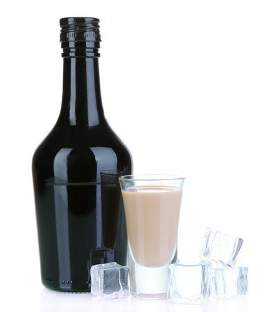 baileys: Baileys liqueur in bottle and glass isolated on white