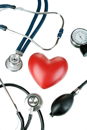 Tonometer, stethoscope and heart isolated on white Stock Photo - 23141930