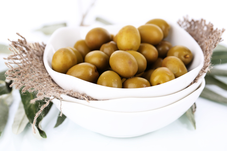 Olives in bowl with branch close up Stock Photo - 23142047