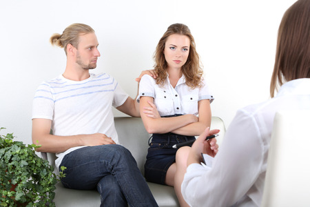 Young couple with problem on reception for family psychologist photo