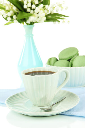 Coffee and macaroons isolated on white photo