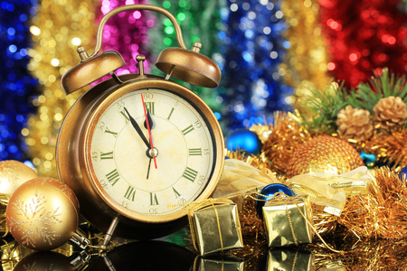 new years eve background: Composition of clock and christmas decorations on bright background