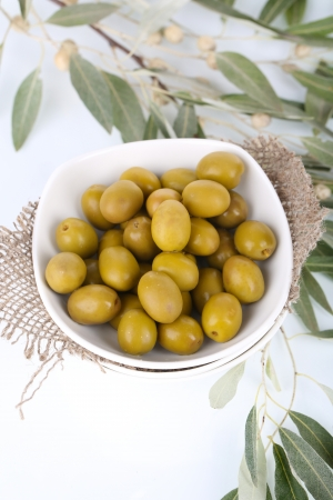 Olives in bowl with branch close up Stock Photo - 23225926
