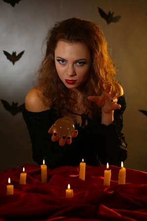 Halloween witch on dark background photo