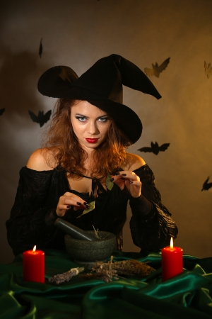 Halloween witch on dark background photo