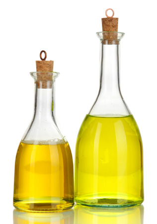 Original glass bottles with salad dressing isolated on white photo