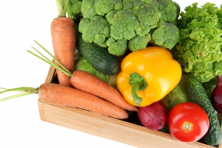 Fresh vegetables in wooden box on grey background photo