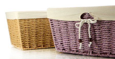 Two empty color wicker baskets, isolated on white photo