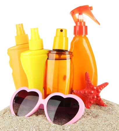 Bottles with suntan cream and sunglasses, isolated on white Stock Photo