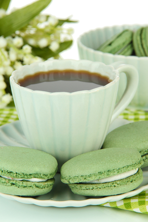 Coffee and macaroons close-up photo