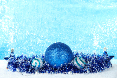 Composition of the Christmas decorations on light blue background photo