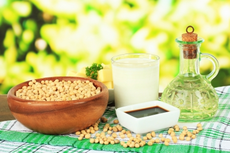 Soy products on table on bright background photo