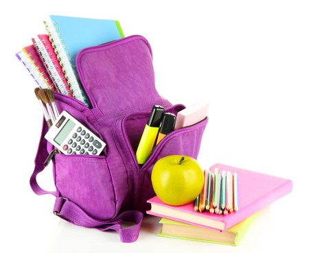 Purple backpack with school supplies isolated on white  photo