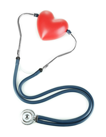 high blood pressure: Stethoscope and heart isolated on white