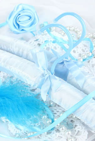 Beautiful hanger on fabric background photo