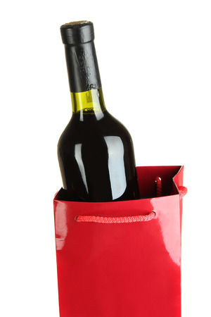 Gift box with wine isolated on white photo