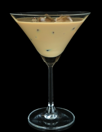 Baileys liqueur in glass isolated on black photo