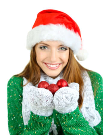 Beautiful smiling girl with Christmas toys isolated on white photo