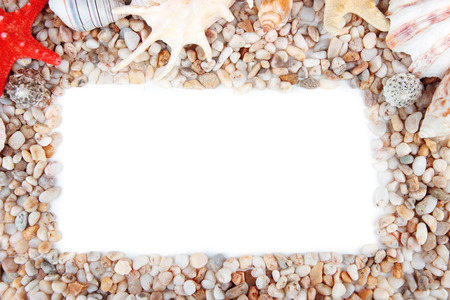 Frame of small sea stones and shells, isolated on white photo
