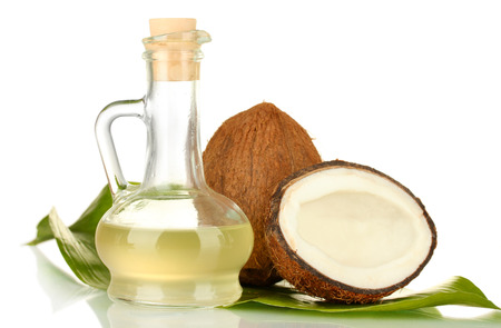 decanter: decanter with coconut oil and coconuts isolated on white