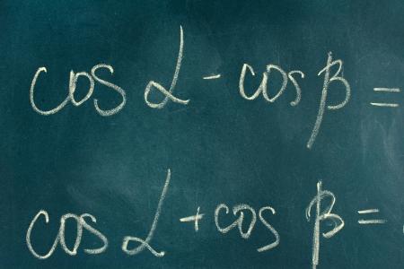 Math formula written on blackboard with chalk. photo