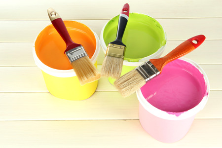 repaint: Set for painting: paint pots, brushes on white wooden table