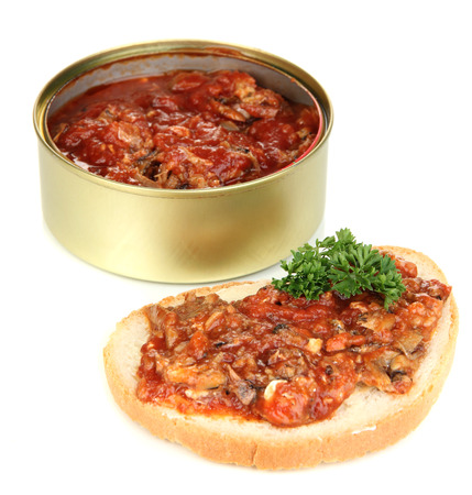 Open tin can with sardines and tomato sauce, isolated on white photo