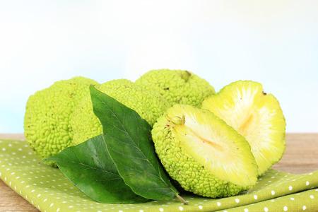 hedgeapple: Osage Orange fruits (Maclura pomifera), on wooden table