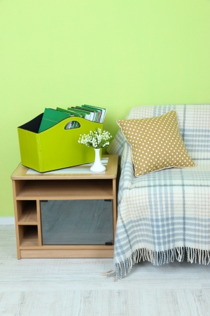 Magazines and folders in green box on bedside table in room Stock Photo - 23794643